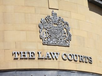 Bradford, England - June 14, 2011: The sign over the entrance to the Law Courts in Exchange Square, Bradford, West Yorkshire.